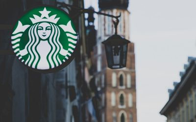 Why was Starbucks ordered to pay, and Hampton Inn was not?