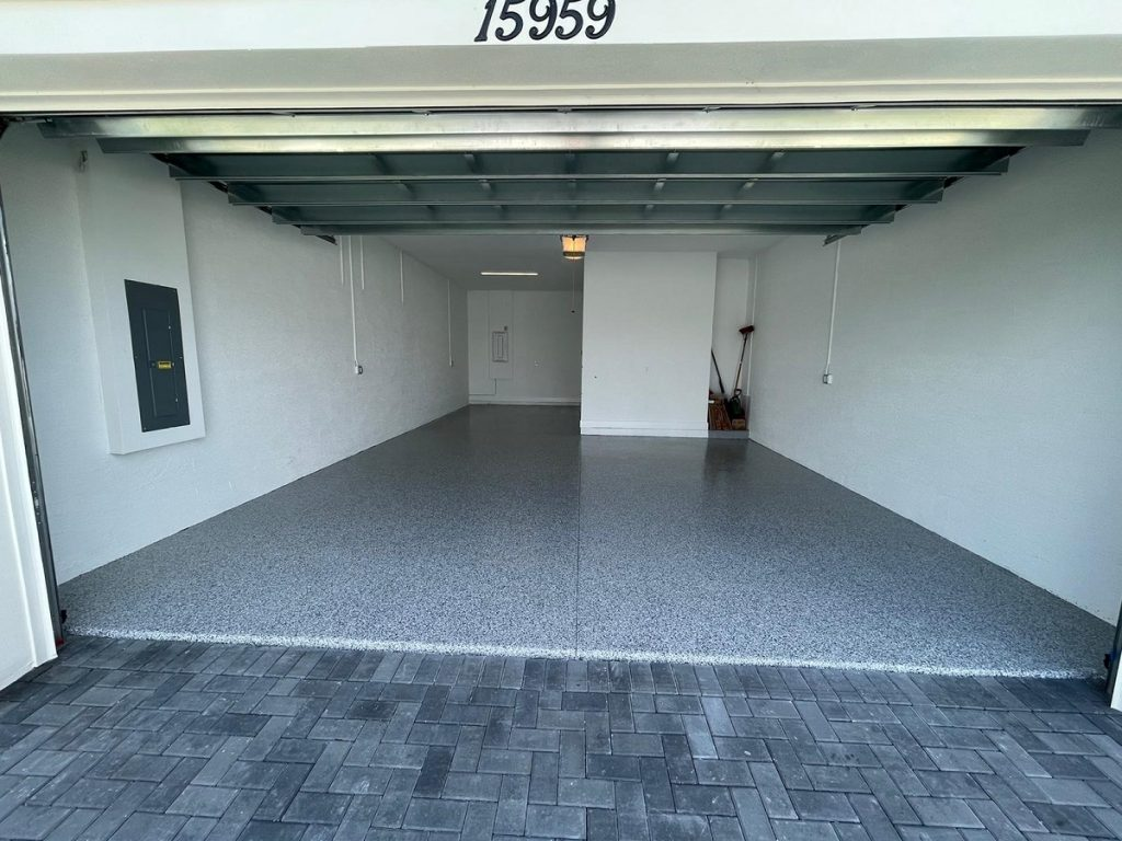 Full flake epoxy garage floor installation in Westlak, Palm Beach County Florida.