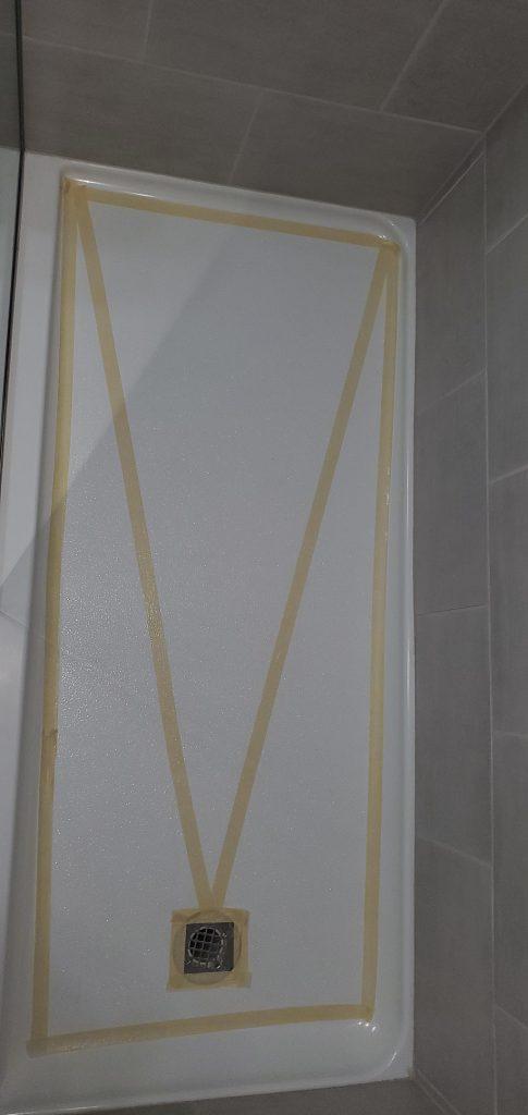 Acrylic shower before SWISS GriP anti-slip coating installation.
