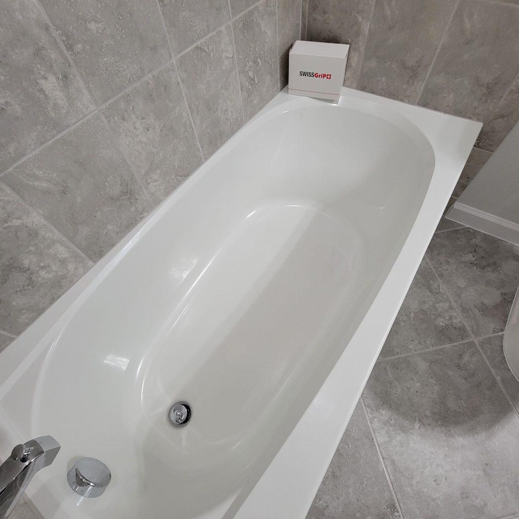 Slipperty bathtub shower before anti slip coating installation.